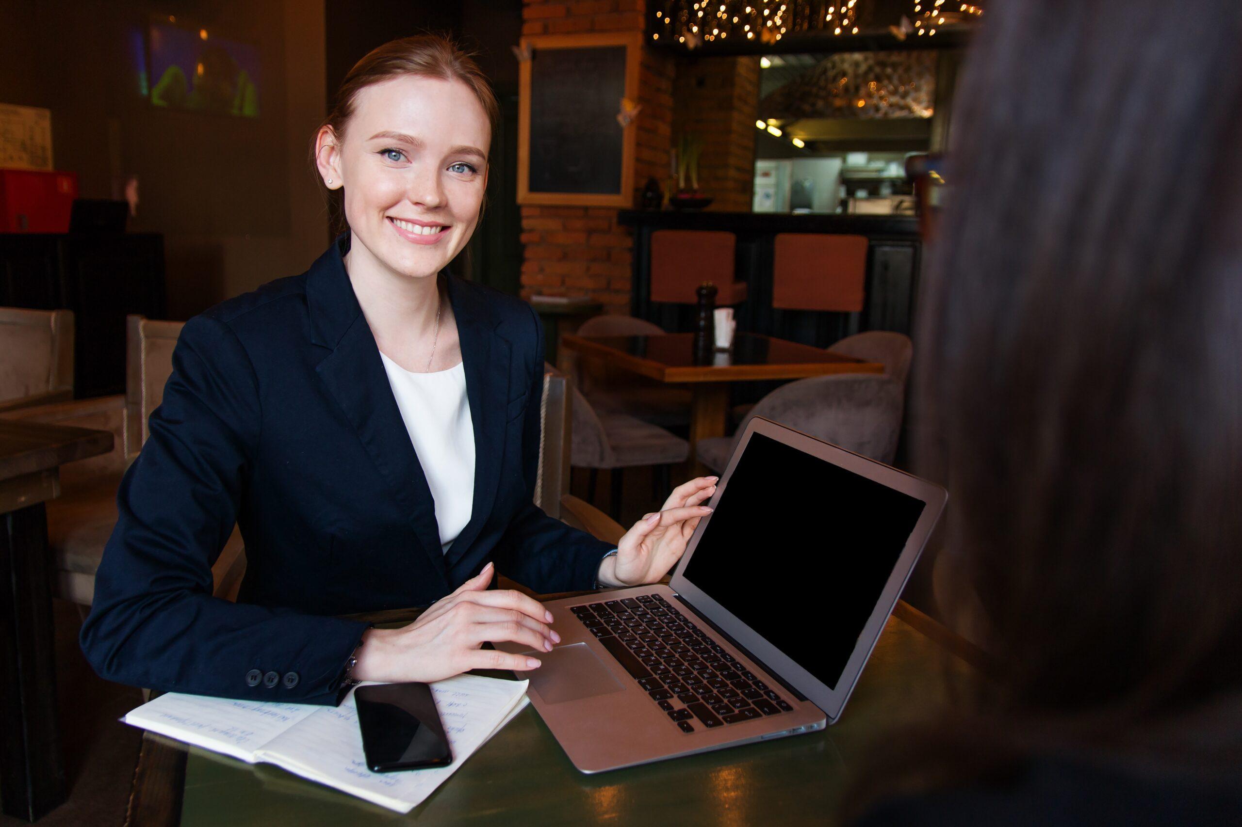smiling woman at laptop